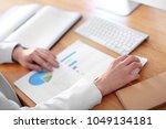 woman working in office.... | Shutterstock . vector #1049134181