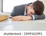 tired businessman with burnout... | Shutterstock . vector #1049161091