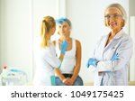 woman getting injection. beauty ... | Shutterstock . vector #1049175425