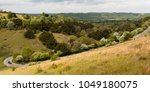 cyclists riding up box hill | Shutterstock . vector #1049180075