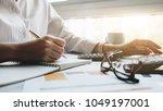 business women using computer... | Shutterstock . vector #1049197001