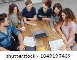 group of young businesspeople... | Shutterstock . vector #1049197439