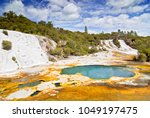 Small photo of Colourful silica terrace formed by hot water algae growing in the geothermal area of Orakei Korako (The Hidden Valley), Northern Island, New Zealand.