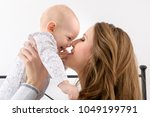happy mother and her baby son...   Shutterstock . vector #1049199791