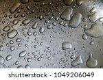 water drop on a steel...   Shutterstock . vector #1049206049
