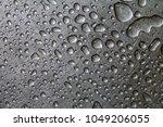 water drop on a steel...   Shutterstock . vector #1049206055