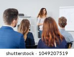 attractive woman lecturing a... | Shutterstock . vector #1049207519