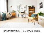 spacious living room interior... | Shutterstock . vector #1049214581