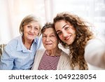 a teenage girl with mother and... | Shutterstock . vector #1049228054