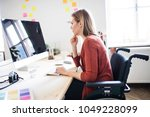 businesswoman in wheelchair at... | Shutterstock . vector #1049228099