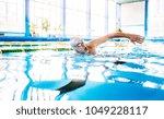senior man swimming in an... | Shutterstock . vector #1049228117