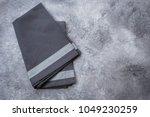 gray kitchen towel on gray... | Shutterstock . vector #1049230259