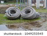 two rolls of isolated pipelines ... | Shutterstock . vector #1049253545