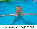 Portrait Of Boy Child Under A...