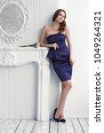 young fashion woman in short... | Shutterstock . vector #1049264321