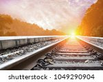 railroad with beautiful sky... | Shutterstock . vector #1049290904