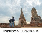 traveler man and women with... | Shutterstock . vector #1049300645