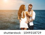 guy and girl on the sea pier... | Shutterstock . vector #1049318729