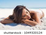 relaxed woman lying down on... | Shutterstock . vector #1049320124