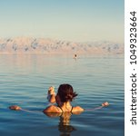 girl is relaxing and swimming... | Shutterstock . vector #1049323664