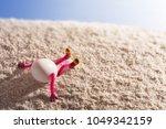 easter egg lying on a sandy... | Shutterstock . vector #1049342159