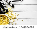 watching movie with popcorn on... | Shutterstock . vector #1049356001
