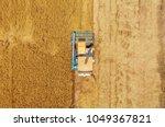 aerial top view harvester... | Shutterstock . vector #1049367821