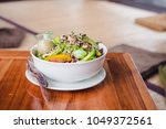 green salad poke bowl with... | Shutterstock . vector #1049372561