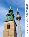 television tower in Berlin beside the Marienkirche - stock photo