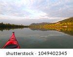 beautiful sunset over the... | Shutterstock . vector #1049402345