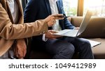 meeting in workplace concept ... | Shutterstock . vector #1049412989