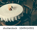 vintage style cafe table in low ... | Shutterstock . vector #1049414501