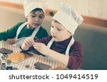 boys in cheefs hats making... | Shutterstock . vector #1049414519