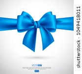 realistic blue bow and ribbon.... | Shutterstock .eps vector #1049418011