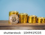 bitcoin coins stack over blue... | Shutterstock . vector #1049419235