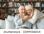 senior couple together at home... | Shutterstock . vector #1049436014