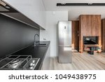 kitchen with fridge  black... | Shutterstock . vector #1049438975