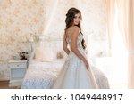 attractive bride in beautiful... | Shutterstock . vector #1049448917