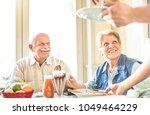 waiter serving senior retired... | Shutterstock . vector #1049464229