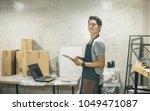 portrait owner in warehouse.... | Shutterstock . vector #1049471087