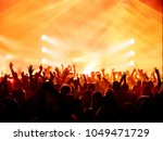 concert crowd at rock concert | Shutterstock . vector #1049471729