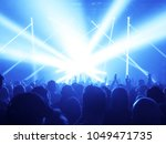 concert crowd at rock concert | Shutterstock . vector #1049471735