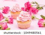 cupcake with pink cream... | Shutterstock . vector #1049480561