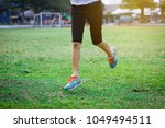 young asian girl is jogging in...   Shutterstock . vector #1049494511
