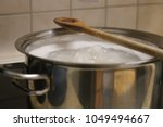 boiling water in a pan  wood... | Shutterstock . vector #1049494667