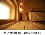 sauna  wooden interior baths ... | Shutterstock . vector #1049495567