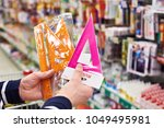 buyer selects plastic rulers... | Shutterstock . vector #1049495981