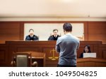 Small photo of back of attastor talking to magistrate in court. the law adjustment concept