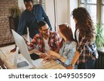 young group of designers... | Shutterstock . vector #1049505509