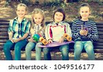 cheerful kids posing together... | Shutterstock . vector #1049516177